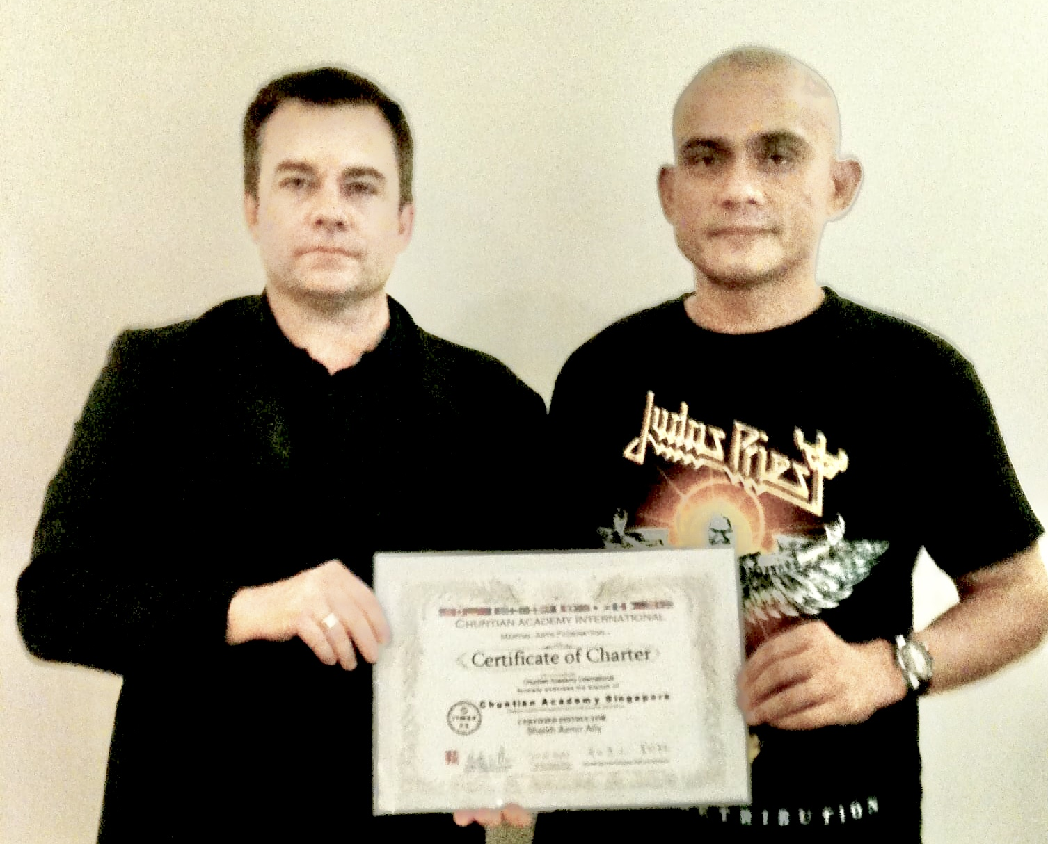 Master Plewes in Singapore granting a school charter to Sheik Azmir after government Martial Arts and Security Approval